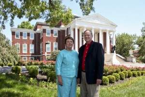 Mrs. Jane Ramsey and UofL President, Dr. James Ramsey in front of Grawemeyer Hall.